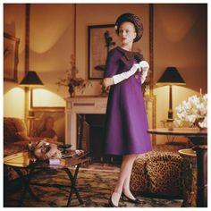 Model Anne Larsen  wearing a Dior suit in the Paris apartment of legendary interior designer Henri Samuel in 1960