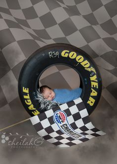 Newborn photography, racing theme, nascar theme by Sheilah G Photography, LLC. Indian Trail, NC newborn photographer.