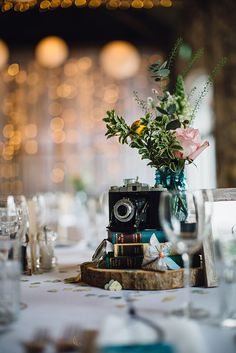 Thrift store travel themed wedding centerpieces abby logans a travel theme inspired spring wedding at askham hall with floral lindybop bridesmaids dresses and a vintage bridal gown by samuel docker photography junglespirit Images