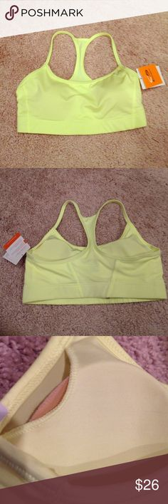 Champion Neon Yellow Sports Bra Champion neon yellow sports bra with Duo Dry + (wicks moisture and dries fast), Power Core Compression (supportive fit), and removable cups (for coverage, shape, and adjustment ability). Padded cups can be adjusted/removed through slits on front inside of sports bra on both right and left side. Body: 84% polyester, 16% spandex. Mesh: 92% polyester, 8% spandex. Machine wash cold. Color is vibrant neon yellow, most similar to first picture. Champion Intimates…