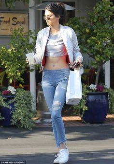Casual but cute: The 20-year-old model teamed the top with fitted jeans and sneakers ...