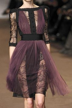 This eggplant and black lace dress has a modernized Downton Abbey feel and a super-flattering silhouette. Love it!