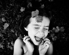 laughing girl with fall leaves