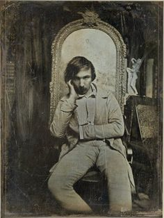 I just found this picture in a very serious website called Gallica. It might be a daguerréotype of Baudelaire taken in the 1850 (he was 29 at that time). Its called Young man sitting in an artist studio but guess what we found on the back of the pictur Old Pictures, Old Photos, Vintage Photos, Essayist, Playwright, Book Writer, Book Authors, Books, Cultura Judaica