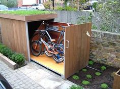 Bike Garage. What about using this idea under the MH? Laying the bikes down on their sides. Would need a pullout for each bike and a way to keep them clean.