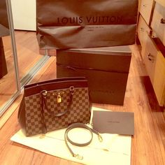 Authentic louis vuitton rivoli Used once and got tone of compliments, eye catching beauty,almost brandnew.comes with everything.. Louis Vuitton Bags