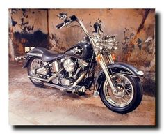 Absolutely Stunning! This unique wall poster adds an instant character with a decorative touch to your home. This poster captures the image of black Harley Davidson motorcycle which is sure to make this poster eye catchy and grab lot of attention. It would be a perfect addition for boy's room. It ensures high quality with high degree of color accuracy.