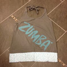 Zumba top Good condition. Still has a lot of wear. Bought this top big so it would hang and be baggy. Zumba Tops Tank Tops