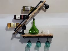 Live edge spalted maple wine rack with black pipe.