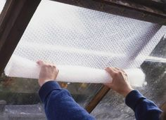 In addition to protecting packages, bubble wrap can also be used to trap escaping air from windows. Cut bubble wrap to size, spray a film of water onto the window, and press the bubble wrap onto the window pane to bid adieu to winter window pains. Bubble Wrap Insulation, Home Insulation, Basement Insulation, Winter Hacks, Winter Tips, Winter Ideas, Basement Windows, Home Fix, Up House