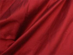 Poly Dupioni Silk - Cranberry Width: 54 Contents: 100% Polyester Fabric Weave: Silk / Faux Silk Design: Solid Brand: N/A Bridal/Fashion / Light Weight Drapery This is a great alternative to pure silk fabric. With its beautiful silky sheen and horizontal slubs that are distinctive characteristics of dupioni silk, you can achieve the elegant look of silk without the silk price