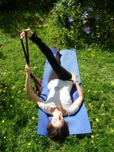 leg stretch with a yoga strap.  Great stretch for hip low back and sciatica.