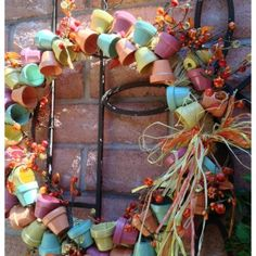 s 30 fabulous wreath ideas that will make your neighbors smile, Connect mini terra cotta flower pots Easy Fall Wreaths, Spring Front Door Wreaths, Spring Wreaths, Terracotta Flower Pots, Clay Flower Pots, Clay Pots, Diy Wreath, Wreath Ideas, Wreath Crafts