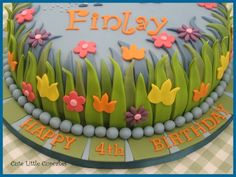 Ben & Holly Cake - love the vibrant detail of the grass & flowers etc  Image sourced from   By Cute Little Cupcakes / Heidi Stone