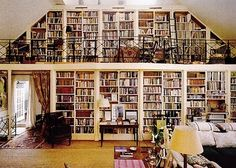 Love built-in shelves and can only hope that I have as plentiful a library as this someday!