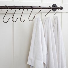 Plumbing Pipe Towel Bar...use tension rod between cabinet and wall with s hooks to dry towels