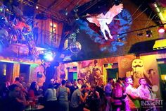 Ideally located in the center of Budapest, Instant Ruin Bar boasts 26 rooms, 7 bars, 2 gardens and 7 stages.