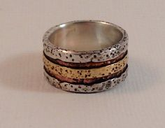 """Women's stunning Rustic Ring with a smooth comfortable fit. Great as a wedding ring or a """"just for me"""" everyday ring. I love the way Sterling naturally ages and oxidizes over time. I like to mix Sterling with copper and/or brass to add interest and style. Handcrafted/fabricated jewelry started from sheets of metal. As a result no two rings are alike, making them unique and timeless. Made to last for generations. Great for """"His and Her"""" rings."""