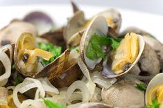 Steamed Clams in White Wine, Butter, Onion and Garlic. Garnish with herbs!