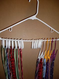 DIY TIE RACK. Use shower curtain rings or clips from the dollar store. Add some hot glue balls along the hanger to keep them from sliding. Perfect for Father's Day!