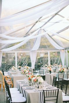 Tented Wedding Reception - Black and White Theme. See more on SMP: http://www.StyleMePretty.com/2014/02/24/modern-new-york-wedding-at-the-foundry/ Photography: Maggie Harkov