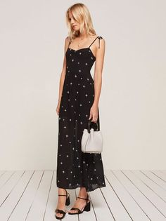 You probably need a vacation. This is an ankle length dress with center front ruching and adjustable strap ties.