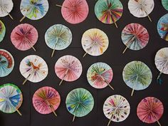 A few years ago my grade 3 students made these Chinese style fans to celebrate Chinese New Year. Each student decorated a very long strip of paper with a Chinese inspired design of their choice. They then had to concertina fold the entire strip and secure the ends to a handle we made from pop sticks.   The idea came from this site, which gives you more details about construction.