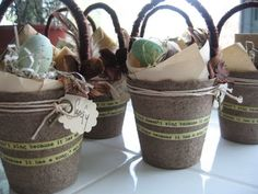 peat pots with a quote and some embellishments added