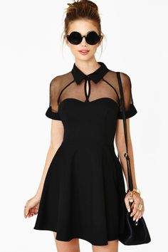 The cutest black dress featuring a sheer organza top with a sweetheart neckline and flared skirt. Zip closure at side, unlined.