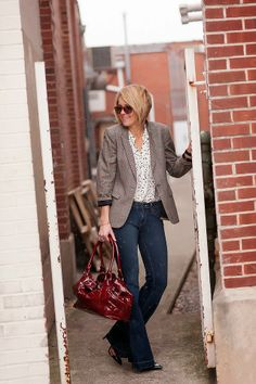 boot-cut jeans + black and white patterned top + grey textured blazer + red tote bag
