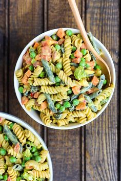 This Vegan Curried Pasta Salad is ready in under 30 minutes and is full of fresh vegetables and plant protein. Perfect for cold lunches or summer cookouts!