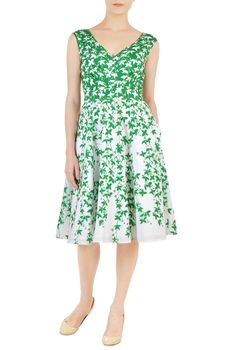 Our feminine style statement this season is our leafy vine print crepe dress styled with chevron pleats at the bodice to add just the right fit for our retro-inspired silhouette.
