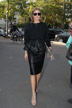 Paris Fashion Week: Olivia enjoyed Maison Martin Margiela and then Andrew Gn in leather —a proper choice with just enough edge to contrast a makeshift peplum hem and her more feminine Aquazzura sandals.