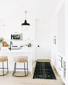 white and wood - replace black accents with gray or brown.  really pretty! #BlackRugs