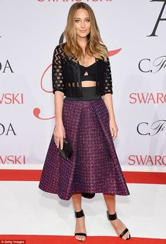 Pretty in purple! Hannah Davis sparkled in a purple sequinned skirt and showed off her toned tum in a black bralette at the CFDA Fashion Awards in New York City on Monday