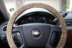 Hey, I found this really awesome Etsy listing at http://www.etsy.com/listing/156294444/cheetah-print-steering-wheel-cover