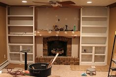 DIY Bookshelves to incorporate fireplace.  Can do speaker wire and lights.  Love!!!!!