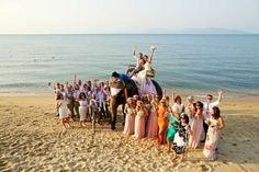 A group shot with a difference. Khun Dton - deluxe package photography. Faraway beach weddings, Thailand.