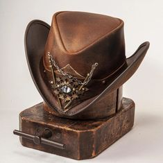 Whether you're looking for a hat to wear sailing the seven seas, or illegally downloading movies in your basement, the One Eyed Willy pirate hat by Steampunk Hatter has got you covered! #hats #leatherhats Pirate Hats, Leather Hats, Red Carpet Event, Mad Hatters, Stunning Eyes, Keep An Eye On, Cool Hats, Hat Making, Leather Working