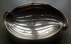 In metal and silvered bronze bowl by LUC LANEL, Art director CHRISTOFLE , ART DECO period, circa 1930-1940; signed under the base. Private collection.