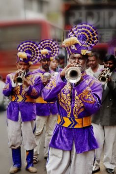 The Pied Players of Pune ~ The marching bands in India dressed in outlandish costumes of the British Raj is a common sight at all marriages where the bride or a groom is from India.