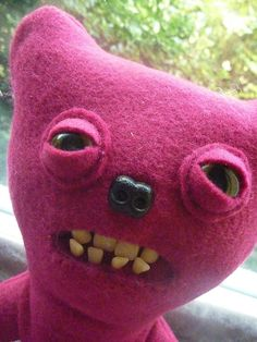 plushies with fake dentures and glass eyes by : http://www.etsy.com/shop/cathairandteeth?ref=l2-shopheader-name