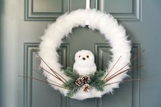 Snowy Owl Christmas Wreath {DIY} - Collectively Christine - - Easy to make snowy owl Christmas wreath tutorial. Add this beautiful wreath to your door or a wall that you want to decorate for the holidays! Christmas Reef, Diy Christmas Snowflakes, Christmas Owls, Christmas Crafts, Christmas Decorations, Christmas Ornaments, Snowflake Wreath, Owl Wreaths, Xmas Wreaths