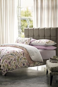 Make the focal point in your bedroom the bed with a floral & bird print bedding and crochet throw to match.
