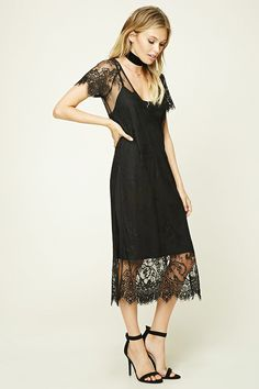 Forever 21 Contemporary - A sheer lace dress featuring a V-neckline, eyelash lace trim, short sleeves, and side vents.