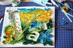 Image of 'quilled typographic paper artwork under construction'