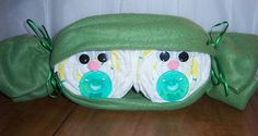 Two Peas In A Pod Diaper Cake I sell these on Etsy as well. I can change up the color of the pacifiers.