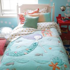 Beautiful appliqued and embroidered details, like waves of airy gauze fabric and metallic accents, are mixed throughout The Land of Nod's Mermaid Mixer Kids Bedding, giving it a gorgeous, layered look. Plus,its soft tones help it mingle with nearly any décor in your girls' bedroom. NOTE: Not for use with actual mermaids.