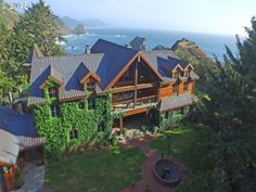 Spectacular private oceanfront property with views of the majestic Three Sisters rock formations & access to two mesmerizing beach coves. The perfect location for this ocean mansion constructed with the finest materials. Wonderful floor to ceiling windows. Extensive brick work & Old World charm will captivate you immediately upon arrival. Included is a 1,460 SF full-scribed Scandinavian Log Guest House also with incredible ocean views., Directions Coy Creek Road
