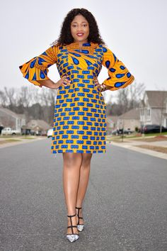Mix-match dress mid-sleeves with flare double layered ends Fits a size Medium, Model is a size Medium Bust: Waist: Hip: Arm length: Arm width: Full dress length: African Print Fashion, African Fashion Dresses, African Dress, Mid Length Dresses, Short Dresses, African Wedding Dress, Ankara Dress, Straight Dress, Ankara Styles